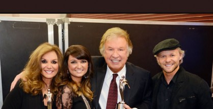 "The Nelons and Bill Gaither, co-writer of ""Excuse Me, Are You Jesus,"" pose with their Silver Telly Awards, backstage during the Gaither Family Fest held in Gatlinburg, TN"